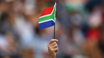 A fan holds the South African flag aloft