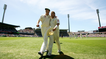 Shane Warne and Glenn McGrath walk off the field