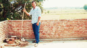Praveen Kumar poses at his village