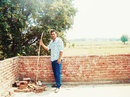 Praveen Kumar poses at his village, Barnawa, June 2015