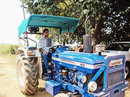 Praveen Kumar drives a tractor, Barnawa, June 2015
