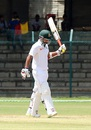 Liton Das raises his bat after reaching a fifty, Karnataka v Bangladesh A, Mysore, 1st day, September 22, 2015
