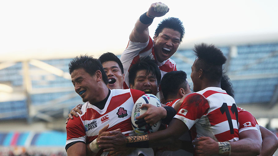 Japan's rugby team celebrate a stunning victory over South Africa