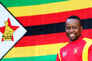 Prosper Utseya looks on with the Zimbabwe flag in the background, United Arab Emirates v Zimbabwe, World Cup 2015, Group B, Nelson, February 19, 2015