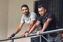 Karnataka team-mates S Aravind and Stuart Binny look on from the balcony, Bangalore, September 23, 2015