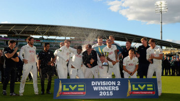 Surrey's players celebrate winning the title