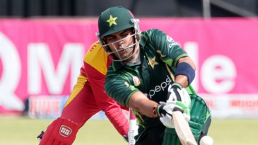 Umar Akmal goes low for a sweep