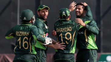 Imad Wasim is mobbed by his team-mates