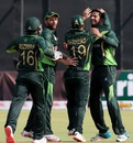 Imad Wasim is mobbed by his team-mates, Zimbabwe v Pakistan, 1st T20, Harare, September 27, 2015