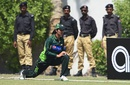 Aliya Riaz stretches with security personnel in the background, Pakistan v Bangladesh, 1st women's T20, Karachi, September 30, 2015
