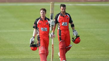 Travis Head celebrates his double-century with Callum Ferguson