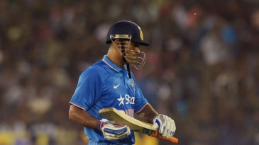 MS Dhoni walks back after scoring 5