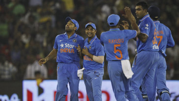 India players get together after R Ashwin takes a wicket