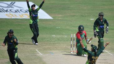 The Pakistan players celebrate the dismissal of Jahanara Alam