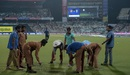 Ground staff work on the outfield at the Eden Gardens, India v South Africa, 3rd T20I, Kolkata, October 8, 2015
