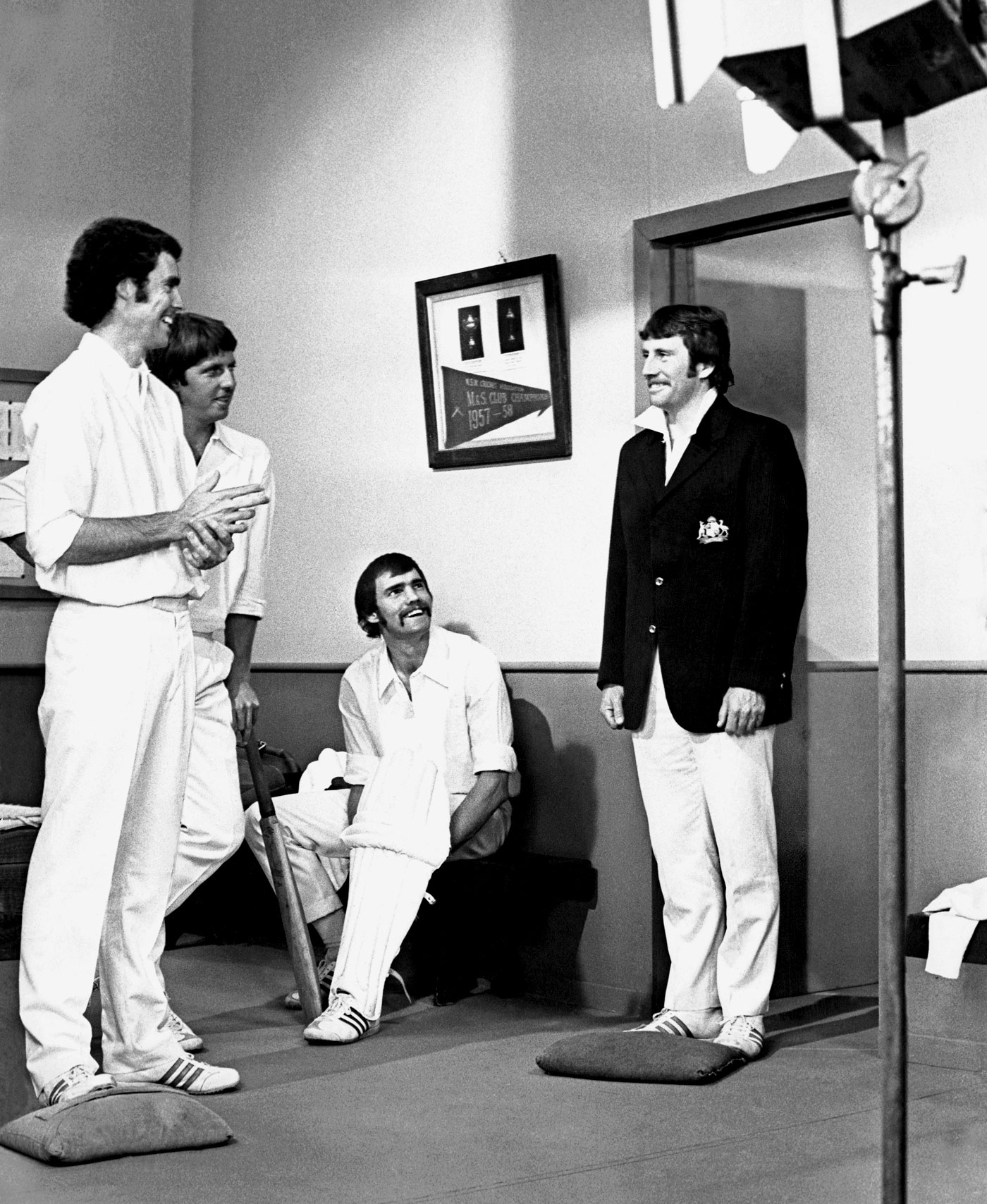 Ian Chappell (in jacket) shoots a television commercial with (clockwise from left) Greg Chappell, Jeff Thomson and Richie Robinson in 1975