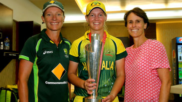 Coach Cathryn Fitzpatrick, captain Meg Lanning and ICC women's committee member Belinda Clark pose with the World T20 trophy