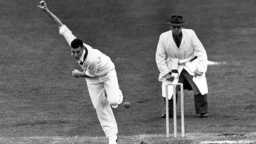 Trevor Goddard bowls in a tour match
