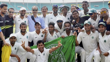 The Assam players get together after their innings win