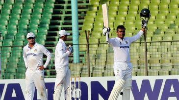Shamsur Rahman raises his bat after making hundred