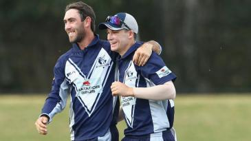Glenn Maxwell and Peter Handscomb celebrate a wicket