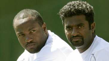 Brian Lara and Muttiah Muralitharan sit on the drinks cart