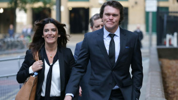 Lou Vincent arrives at Southwark Crown Court with his partner