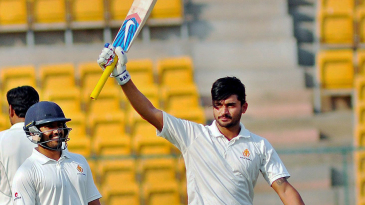 Manish Pandey raises his bat after scoring his 16th first-class century