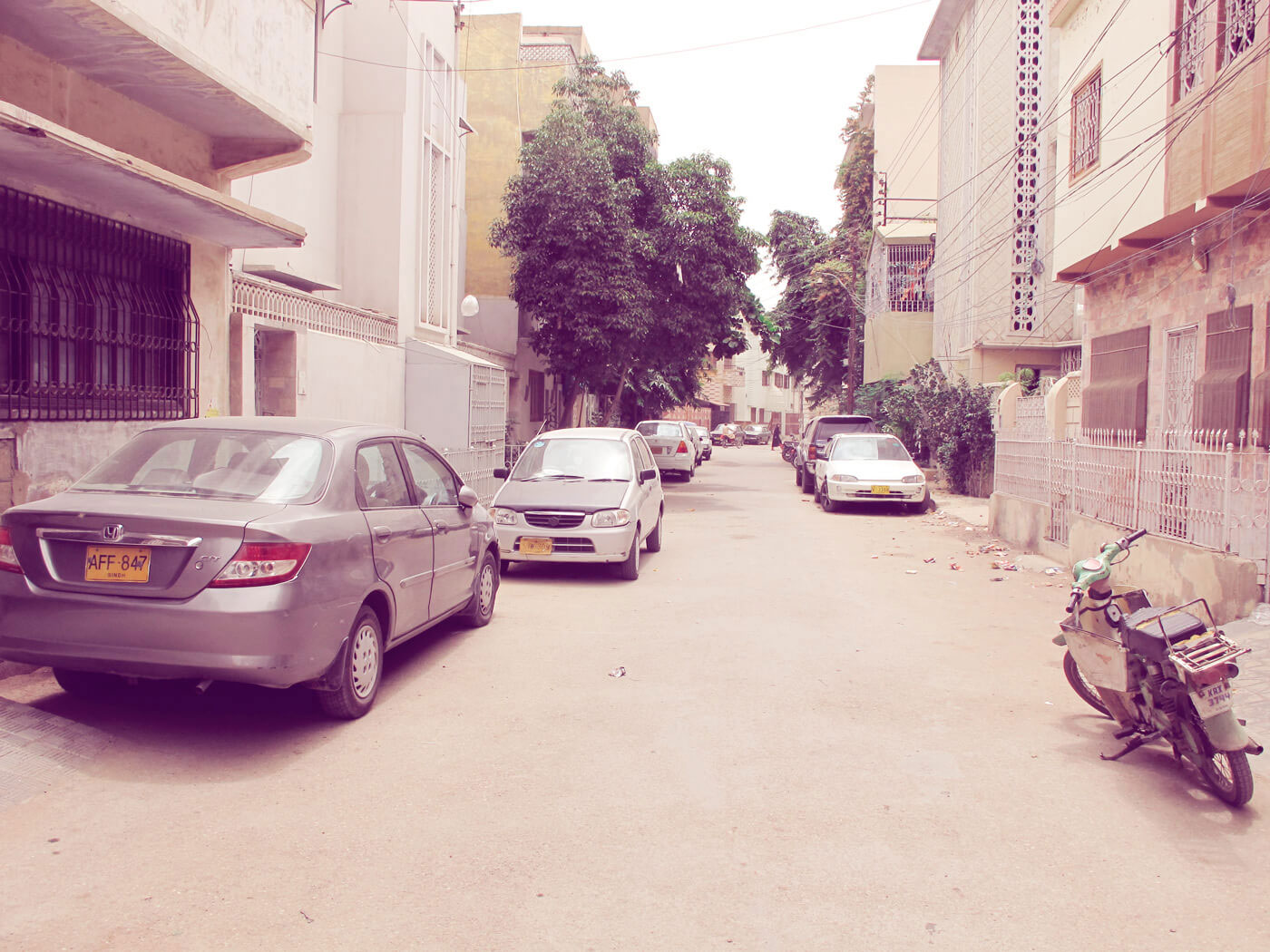 Mind the windows: an influx of cars has led to a space crunch for cricket in the streets, like in Nazimabad above