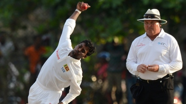 Tharindu Kaushal in his delivery stride