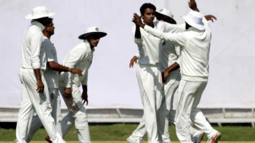 Hyderabad surround CV Milind after he dismisses Paras Dogra for a duck