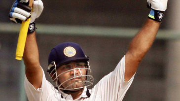 Virender Sehwag celebrates his fifty against his former team, Delhi