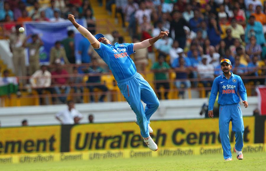 Suresh Raina dives for a catch off Faf du Plessis   Photo ...