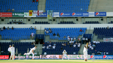 James Anderson bowls in a virtually empty Sheikh Zayed Stadium in Abu Dhabi