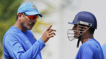 Ravi Shastri and MS Dhoni chat during a training session