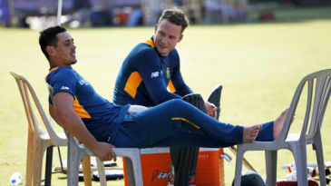 Quinton de Kock and David Miller take a break during a practice session