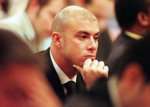 Cricketer Herschelle Gibbs listens to the testimony of former South African cricket captain Hansie Cronje at the King Commission of Inquiry into allegations of cricket match-fixing in Cape Town 15 June 2000. Gibbs has been suspended from the South African cricket team following his involvement in the scandal.
