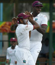 Devendra Bishoo and Jason Holder celebrate the wicket of Dimuth Karunaratne, Sri Lanka v West Indies, 2nd Test, Colombo, 2nd day, October 23, 2015