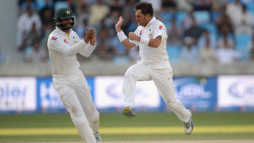 Yasir Shah celebrates the dismissal of Alastair Cook