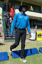 Umpire Langton Rusere walks in for his international debut, Zimbabwe v Afghanistan, 5th ODI, Bulawayo, October 24, 2015