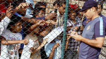 Crowd puller: Virender Sehwag signs autographs