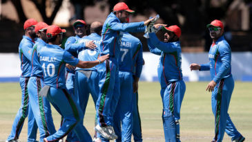 Mirwais Ashraf celebrates a wicket with his team-mates