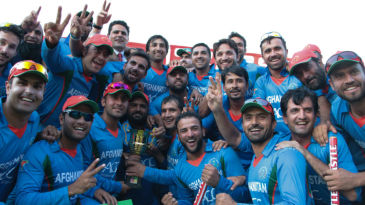 The Afghanistan players pose with the trophy
