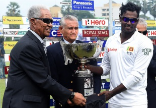 Angelo Mathews collects the trophy from Garry Sobers and Michael Tissera, Sri Lanka v West Indies, 2nd Test, P Sara Oval, Colombo, 5th day, October 26, 2015