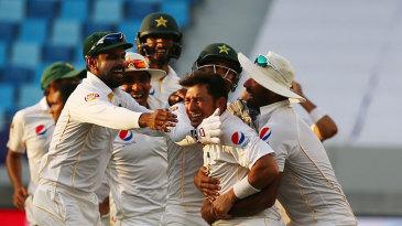 Pakistan's fielders mob Yasir Shah after Pakistan's thrilling win