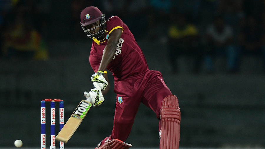 Jason Holder plays a lofted shot during his 13-ball 36