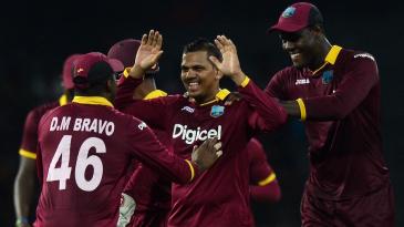 Sunil Narine celebrates with his team-mates after dismissing Shehan Jayasuriya