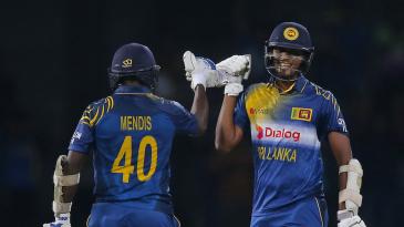 Ajantha Mendis and Suranga Lakmal celebrate Sri Lanka's narrow victory over West Indies