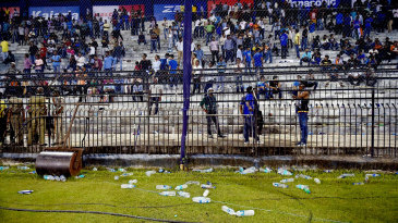 Play is held up as bottles rain on to the ground from the stands