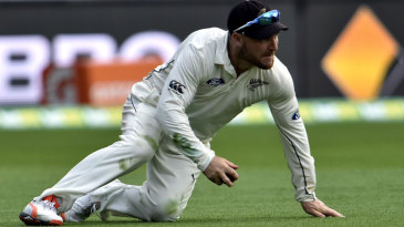 Brendon McCullum cleans up in the field